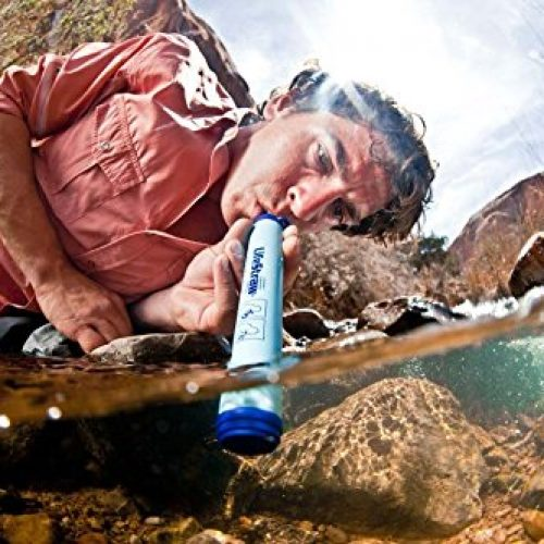 backpacker using LifeStraw survival water filter